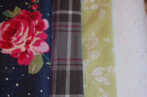 L-R: blue rose/ dotted cotton, grey checked cotton, light green/ white floral print cotton, white broiderie anglaise.