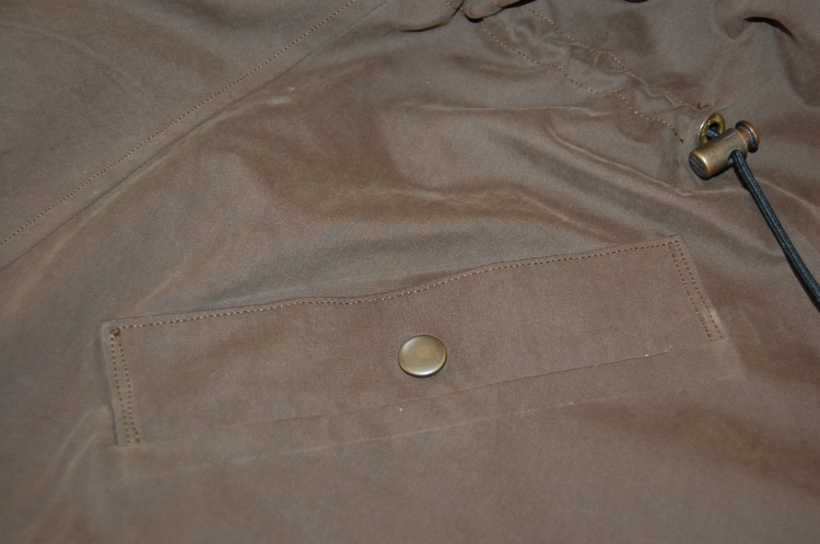 Khaki Waterproof Minoru Jacket - single welt pocket and adjustable elasticated waist detail