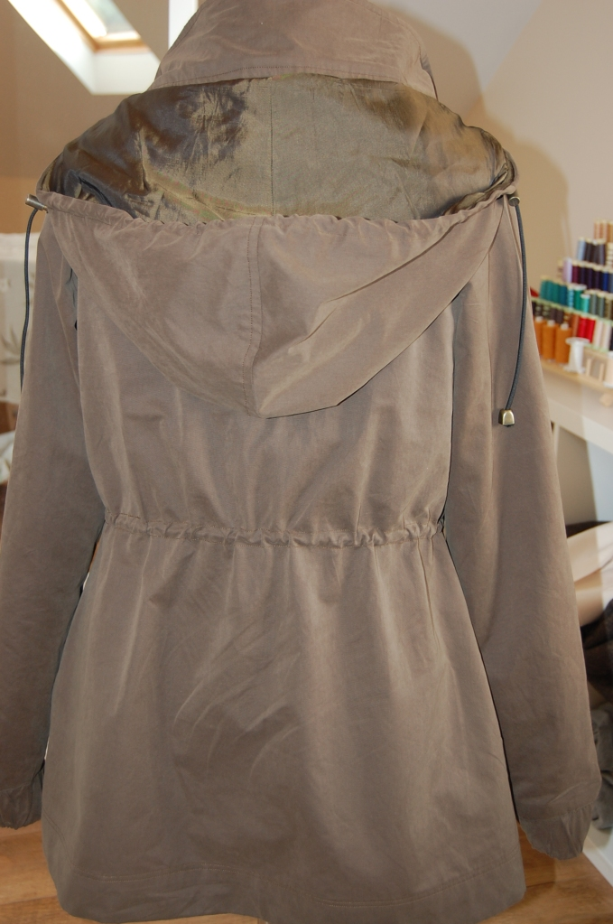 Khaki Waterproof Minoru Jacket - back view on dress form