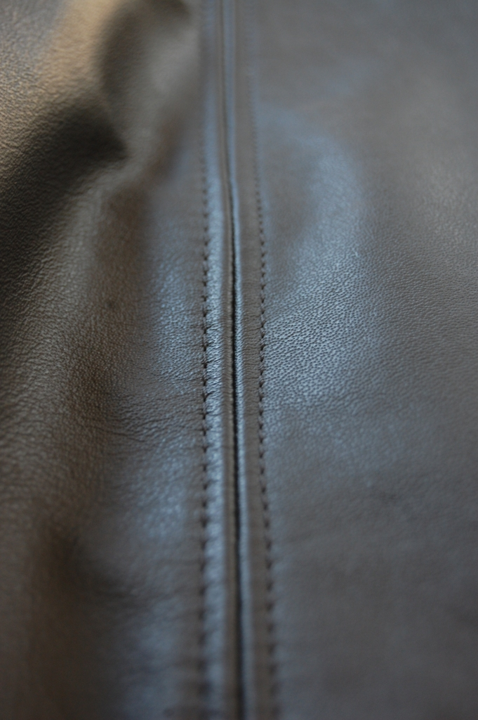 Butterick 6169: DIY Black Leather Collarless Biker Jacket - close up of topstitched seams