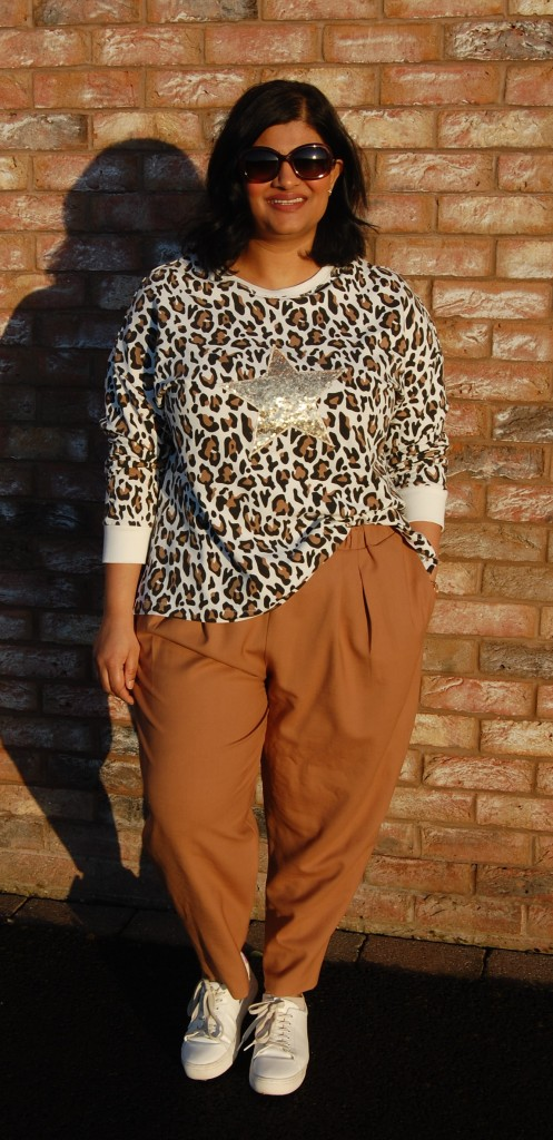 McCalls 7688 animal print sweatshirt with sequin star applique motif. Worn with Simplicity 8339 camel pants.